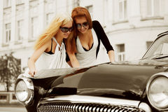Two young women with a road map Royalty Free Stock Photo