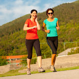 Two young women running outdoor. On a track Royalty Free Stock Photography