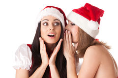 Two young women in Santa costume. Royalty Free Stock Photo