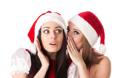 Two young women in Santa costume. Stock Photo