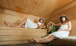 Two young women in sauna Royalty Free Stock Photography