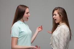 Two young women screams at each other Royalty Free Stock Images