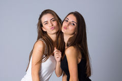 Two young women sending kisses Royalty Free Stock Images