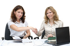 Two young women shaking hands Royalty Free Stock Photo