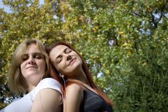 Two young women sharing music Stock Image