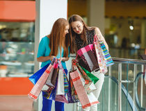 Two young women shop in a big supermarket. Stock Photography