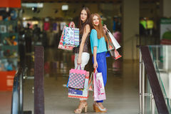 Two young women shop in a big supermarket. Royalty Free Stock Images