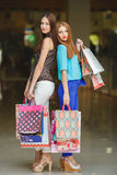 Two young women shop in a big supermarket. Stock Image