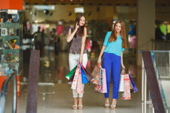 Two young women shop in a big supermarket. Royalty Free Stock Photography