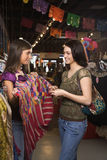 Two Young Women Shopping stock images