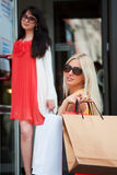 Two young women shopping stock photos