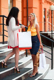 Two young fashion women with shopping bags Royalty Free Stock Photo