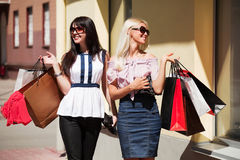 Two young women shopping. Stock Images