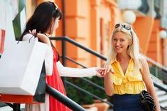 Two young women shopping. Stock Photos