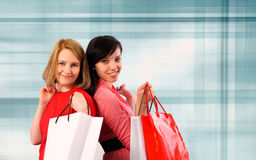 Two young women shopping Royalty Free Stock Photos
