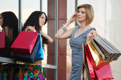 Two young women with shopping bags. Stock Photography