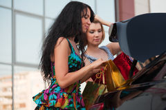 Two young women with a shopping bags. Royalty Free Stock Photography