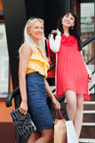 Two young women with shopping bags. Stock Photos