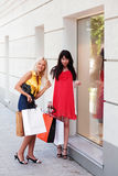 Two young fashion women with shopping bags Stock Photography
