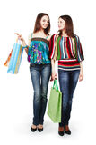 Two young women with shopping bags. Isolated on white background Stock Image