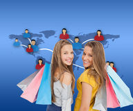 Two young women with shopping bags Stock Image