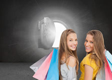 Two young women with shopping bags Royalty Free Stock Photo