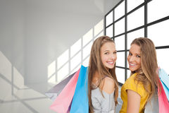 Two young women with shopping bags Royalty Free Stock Photos