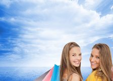 Two young women with shopping bags Stock Images