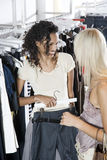 Two young women shopping for clothes Stock Photo