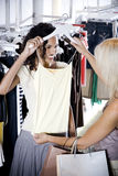Two young women shopping for clothes Stock Photography