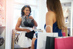 Two young women shopping for clothes Royalty Free Stock Photography