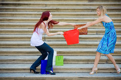 Two Young Women Shopping. Holdings shopping bags Royalty Free Stock Photography