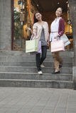Two young women shopping looking at the Camera Royalty Free Stock Images