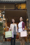 Two young women shopping looking at the Camera Stock Images