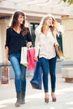 Two young women shopping at the mall Royalty Free Stock Photography