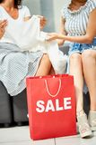 Two Young Women Shopping on Sale Stock Photos