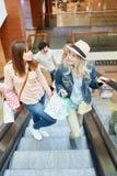 Young women on an escalator stock image
