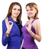 Two young women showing OK sign Royalty Free Stock Photo