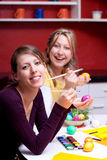 Two young women smiling with Easter eggs Stock Photo