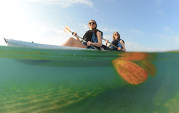 Two young women smiling in kayak Stock Photography