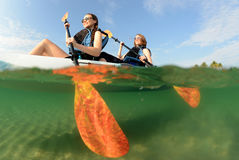Two young women smiling in kayak Royalty Free Stock Photo