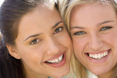 Two young women smiling, portrait, close-up Stock Photos