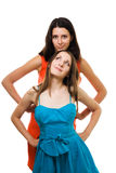 Two young women stand together in vivid color dres Stock Photography