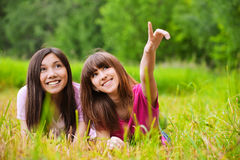 Two young women stare to the sky Stock Photography