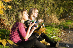 Two young women starts up soap bubble Stock Photos