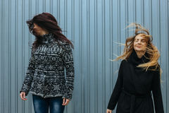 Two young women with straight long hairs in motion Royalty Free Stock Photography