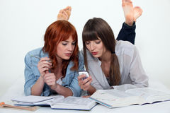 Two young women studying Stock Photo