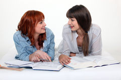 Two young women studying Stock Images