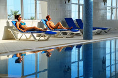 Two young women at the swimming pool Stock Image