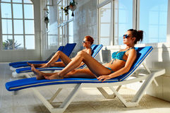 Two young women at the swimming pool Royalty Free Stock Image